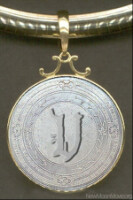 Кулон - символ Вольтури